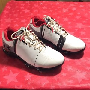 Under Armour youth size 6 golf cleats.